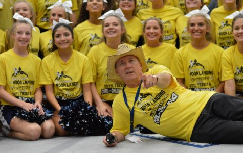 "Golden tooth \ Principal Mr. Mike Williams shows off his ""gold out"" attire for group photo at the end of the pep rally. The yellow t-shirts were sold for $10, $7 of each sale went back to support childhood cancer research."