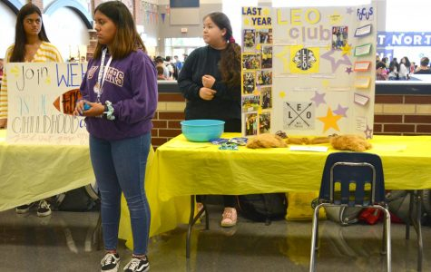 Come join the club \\ Leo Club members advertise their organization during Rush Week Sept. 3.