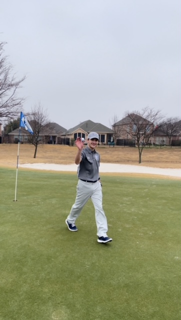One+shot%2C+one+hole+%5C%5C+Sophomore+Carson+Tittle+grabs+his+hole-in-one+ball+from+the+hole+to+celebrate.+He+played+with+the+junior+varsity+boys+team+at+the+RHS+Big+4+competition+at+Waterview+Golf+Course+Feb.+8.+%E2%80%9CI+have+not+gotten+a+hole+in+one+at+a+competition+before.+In+fact%2C+this+was+my+first+hole+in+one%2C%E2%80%9D+Tittle+said.