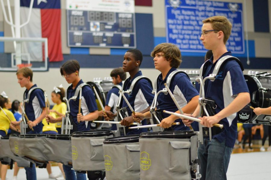 "On a roll \ Facing juniors and seniors, drumline performs a piece titled ""Spice Mon."" The drumline took center stage at the rally, hyping up the student body and football team before they opened their season against North Forney. ""It was incredibly gratifying to show off our hard work for an audience,"" sophomore snare player Daniel Cline said."