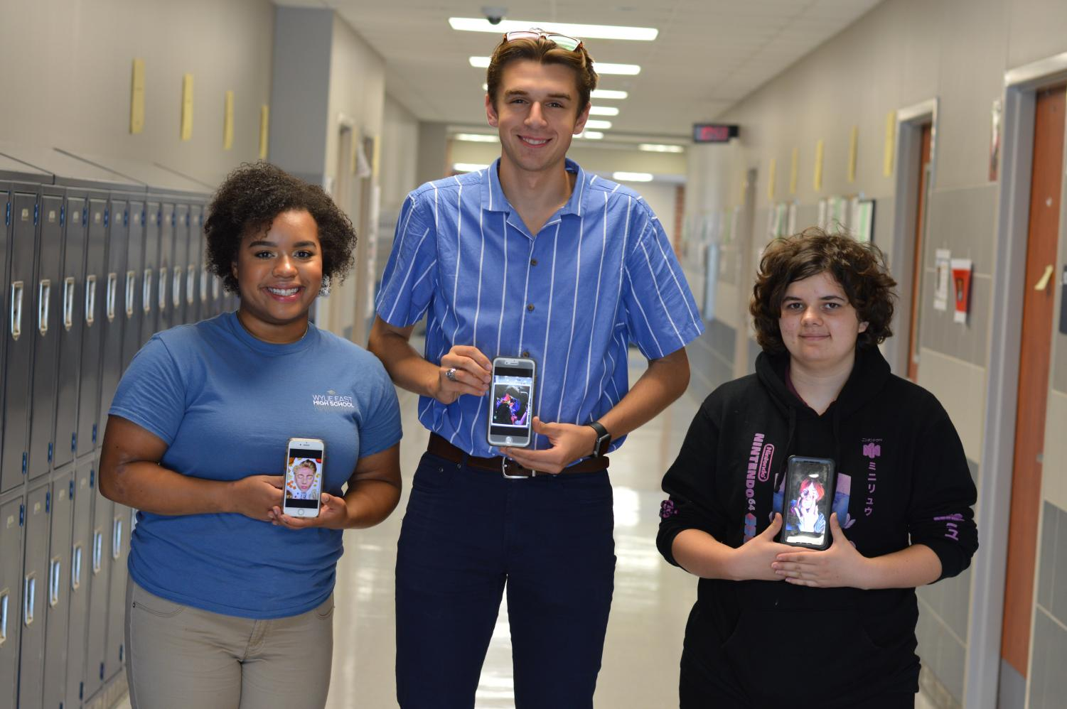 Thompson's top trainees \\ Seniors Kaylah Casasola,  Zachary Clore and Lexi Branch show off their artwork for the Texas Association of School Boards 2019 Conference Students Show. Students in the Dallas area send in their artwork for display and these students' work was selected to compete.
