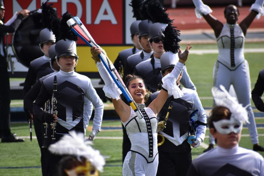 On+the+rise%5C%5C+Sophomore+Arianna+Perez+hits+her+final+pose+of+the+band+show%27s+second+movement+based+around+Mass+Media.+The+band+competed+at+the+UIL+Area+Marching+Competition+and+placed+high+enough+to+earn+a+highly+coveted+spot+in+the+State+competition+in+San+Antonio.+