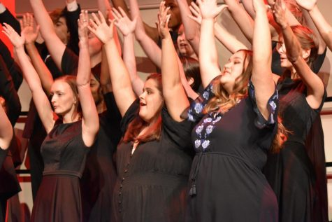 "Acapella Choir finishes one of the only choreographed songs, Balleilakka, with flare. The Fall concert, put together by Mr. and Mrs.Dame, had six choirs all showcasing all of their work so far this year. ""It was so fast and fun to do."" sophomore Cheyann Hicks said."