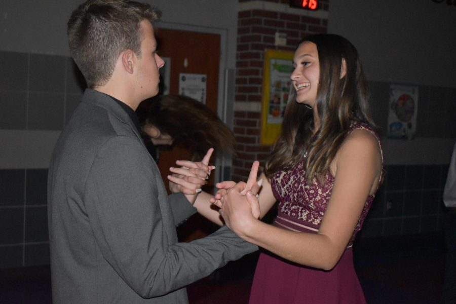 A+dance+to+remember+%5C+Freshman+Kirsten+Hight+enjoys+her+time+at+the+dance+with+senior+Caed+Rodgers.+%E2%80%9CEven+though+the+music+wasn%E2%80%99t+the+best%2C+I+still+had+a+great+time+with+him%2C%22+Hight+said+Oct.+19