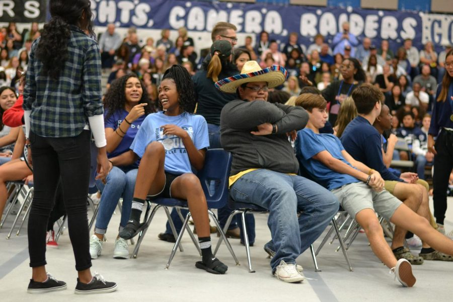 "Musical mayhem \ Participating in an intense game of musical chairs, students from each grade level attempt to snatch the last chair before the music ends at the homecoming pep rally Oct. 18. ""My strategy was to booty bump whoever sat in the chair I was going to sit in and therefore always have a chair,"" sophomore and player Luis Lopez said. ""Also, the sombrero gave me a boost because no one could get near me."""