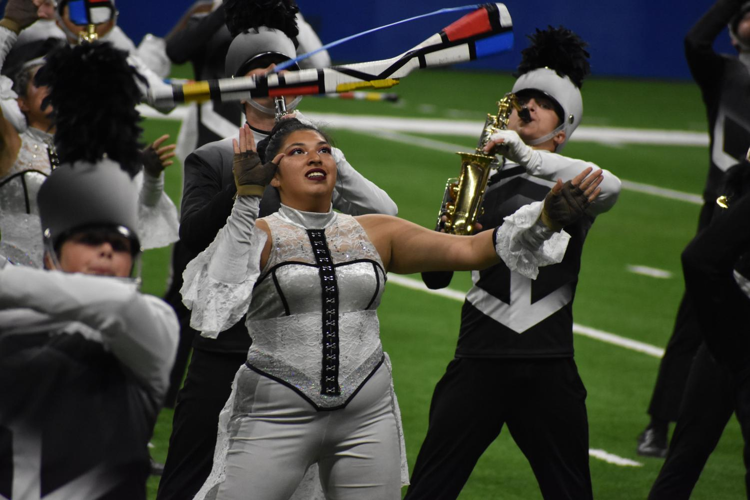 Toss up\\ Senior Stephanie Rodriguez tosses a rifle during the second movement, Mass Media, of the state-bound show entitled