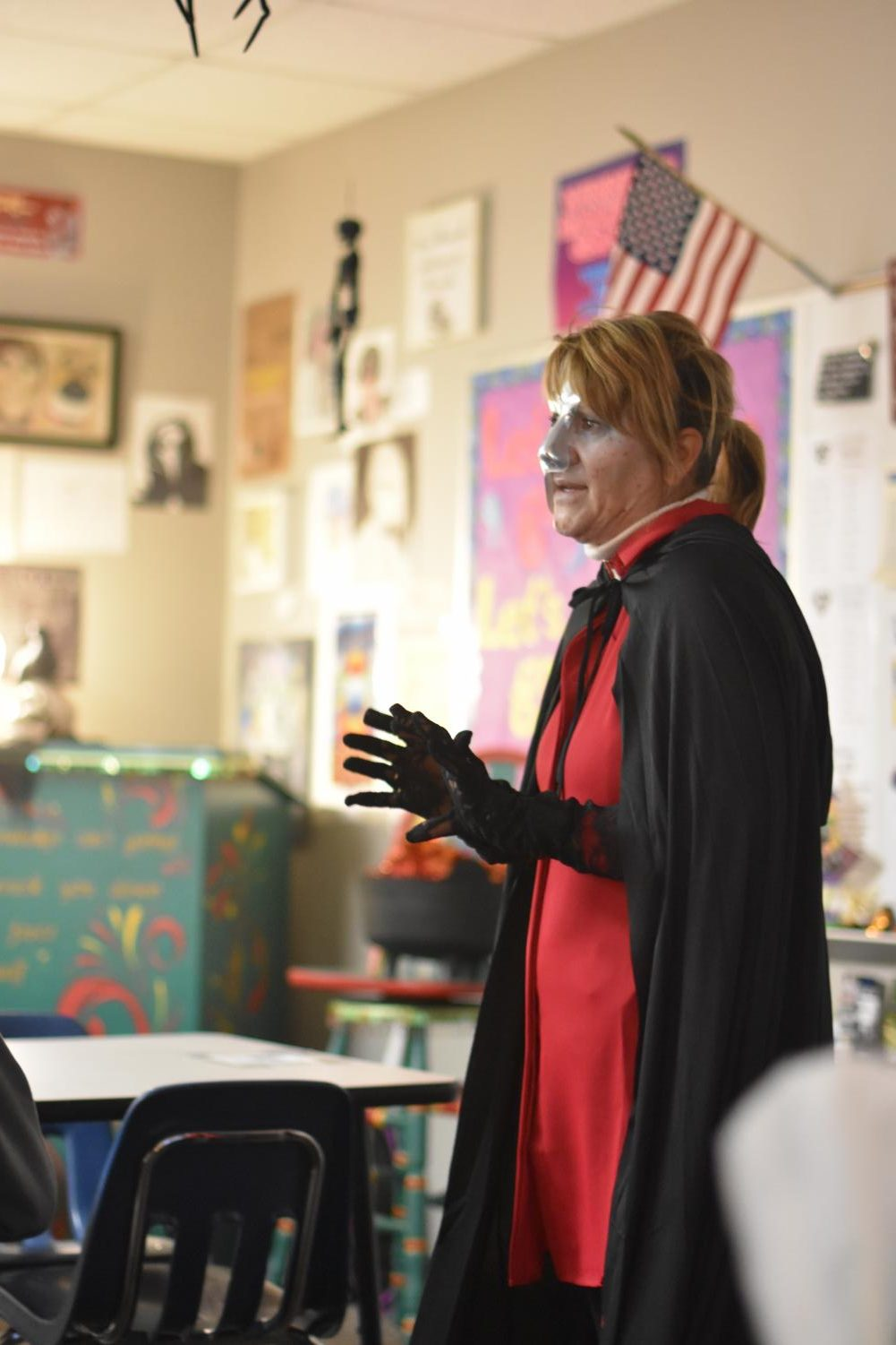 "English excitements // Explaining Edgar Allan Poe's short story, English III teacher Mrs. Elizabeth Simmons shares her favorite short story to her first period class Oct. 30 in honor of the last day of Teen-Tober. Teen-Tober, hosted by the librarians, encouraged teen reading around the school. ""Poe is a master of the macabre, so what a better time to delve into his work than Halloween?"" Simmons said."