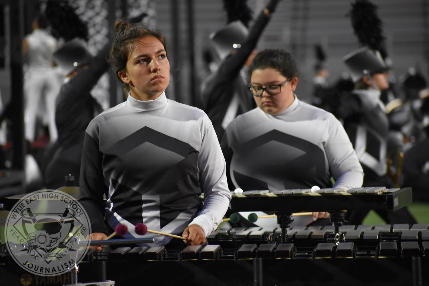 Focused+vibes+%5C%5C+As+she+watches+the+drum+majors%2C++sophomore+Kaitlin+Wiltcher+plays+her+vibraphone+during+the+band%E2%80%99s+performance+at+the+Wylie+Band+Night+Oct.+7.+The+band%E2%80%99s+show+is+titled+MASSive+and+features+music+from+Mozart%E2%80%99s+Requiem%2C+John+Adams%E2%80%99+Short+Ride+in+a+Fast+Machine%2C+Andrew+Lloyd+Webber%E2%80%99s+Masquerade+and+original+music+from+Christopher+Bill.+%E2%80%9CIt+was+cool+to+see+all+the+junior+highs+play+and+get+excited+over+watching+their+high+schools+perform%2C%E2%80%9D+Wiltcher+said.