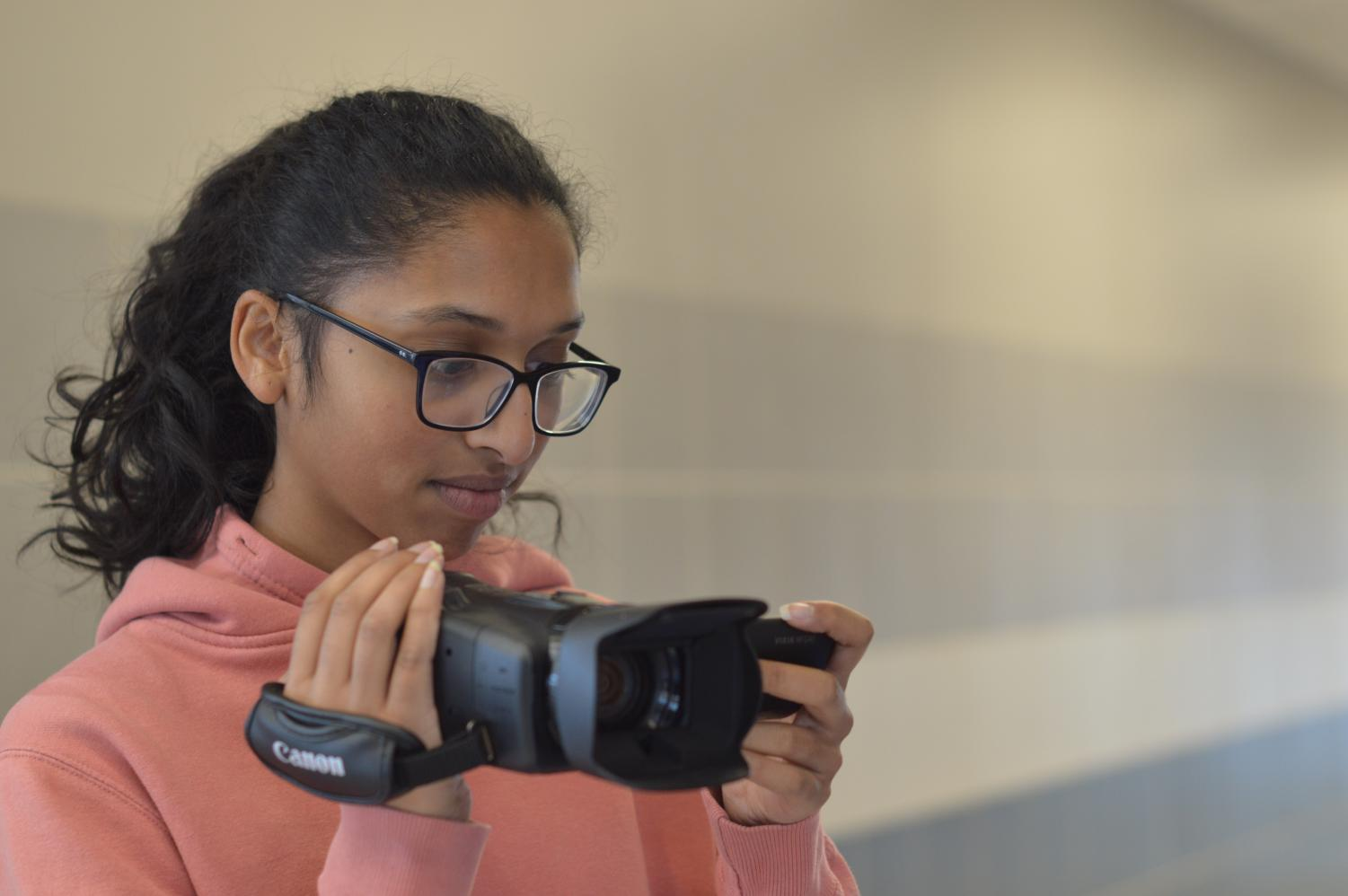 """Filming the halls, Elizabeth Thomas puts her skills to the test. """"I am trying to familiarize myself with programs used in the industry and I just keep working on my skills and trying to come up with ideas for videos and possible short films,"""" senior Elizabeth Thomas said."""