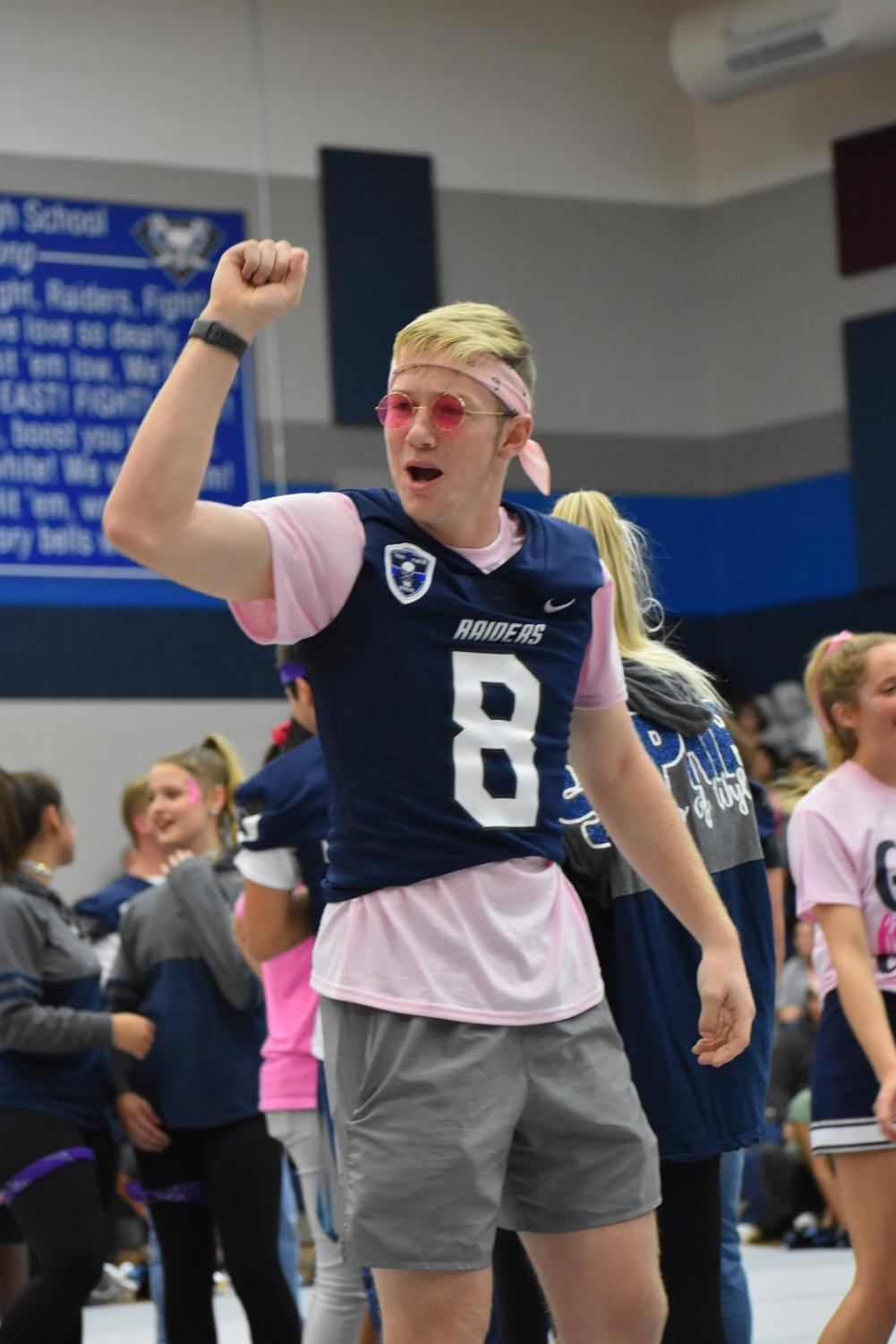 Raise+%E2%80%98em+up+%5C%5C+Cheering+on+the+stands%2C+senior+Luke+Bumpus%2C+wraps+up+his+speech+pumping+up+the+crowd+at+the+Pink+Out+pep+rally+Oct.7.
