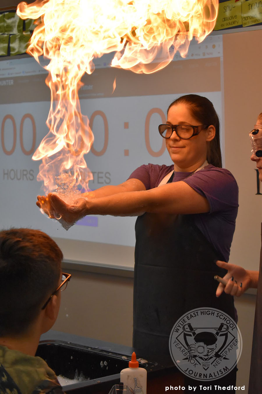Girl+on+fire+%5C%5C+Holding+the+methane+flames%2C+chemistry+teacher+Mrs.+Lissa+Groter+demonstrates+to+her+first+period+chemistry+class+proper+safety+techniques+Nov.+20.+%22The+experiment+isn%E2%80%99t+scary+for+me+because+I%E2%80%99ve+done+it+before.+I+was+a+little+nervous+the+first+time+I+did+it%2C%22+Groter+said.