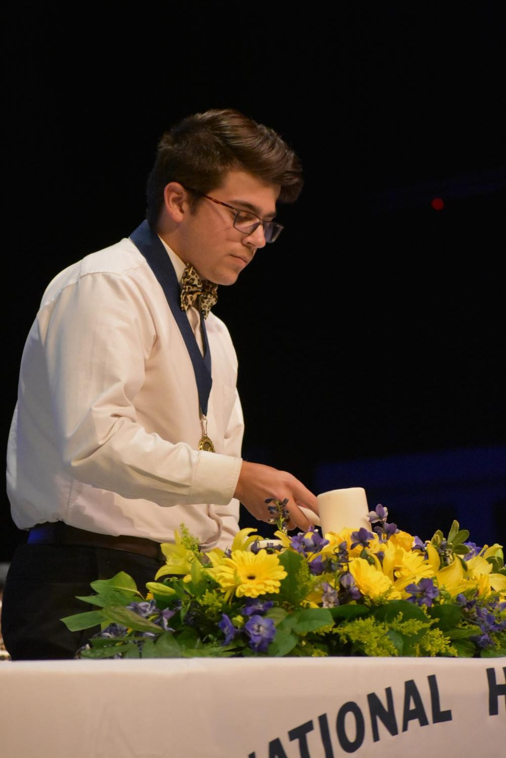 Shining bright \\ Senior Jaron Harbison helps lead the National Honor Society's induction ceremony.