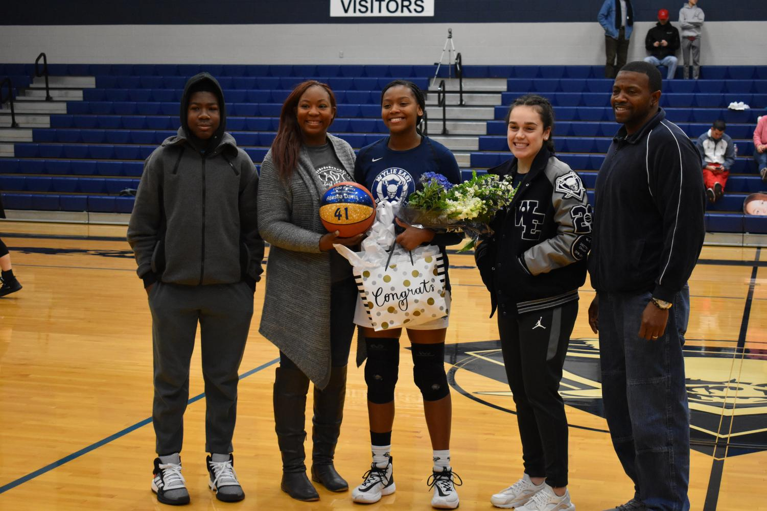 Record setter \ \ Before a game, junior Akasha Davis, celebrates her accomplishment of getting 1000 points throughout her varsity career. Davis has played three years on the girls varsity basketball team. The team played Lovejoy High school Jan.11 and won 65-39.