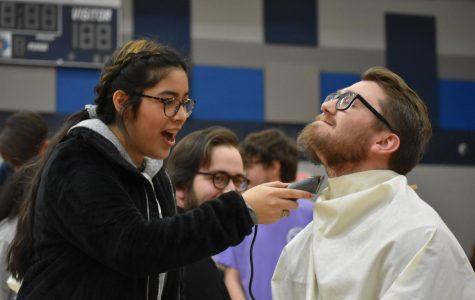 Initial shock \\ Sophomore Suzie Martinez shaves Mr. Zach Neu's beard Feb. 21 for the
