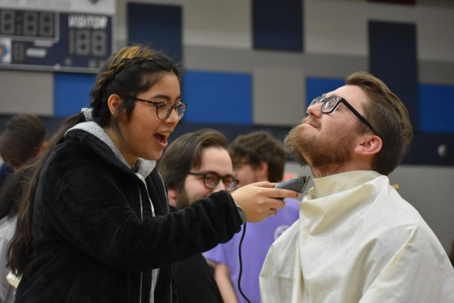 Initial shock \\ Sophomore Suzie Martinez shaves Mr. Zach Neu's beard Feb. 21 for the