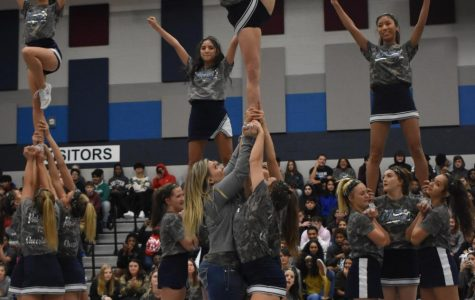 """Stunt double \\ When sophomore Abby Malhiot rolled her ankle mid-routine, cheer sponsor Mrs. Amy Torres didn't miss a beat to sub in for her. """"I was happy to step in to assist with the routine,"""" Mrs. Torres said."""