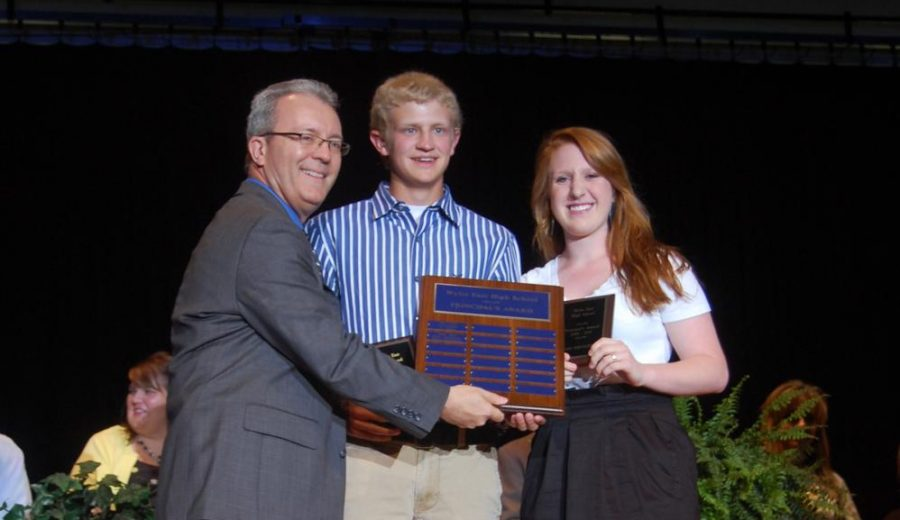 In the beginning \\ Principal Mike Williams presents alpha class members Chance Grantham and Cassi Springfield with the principal's award at the  first-ever senior awards ceremony in 2012.