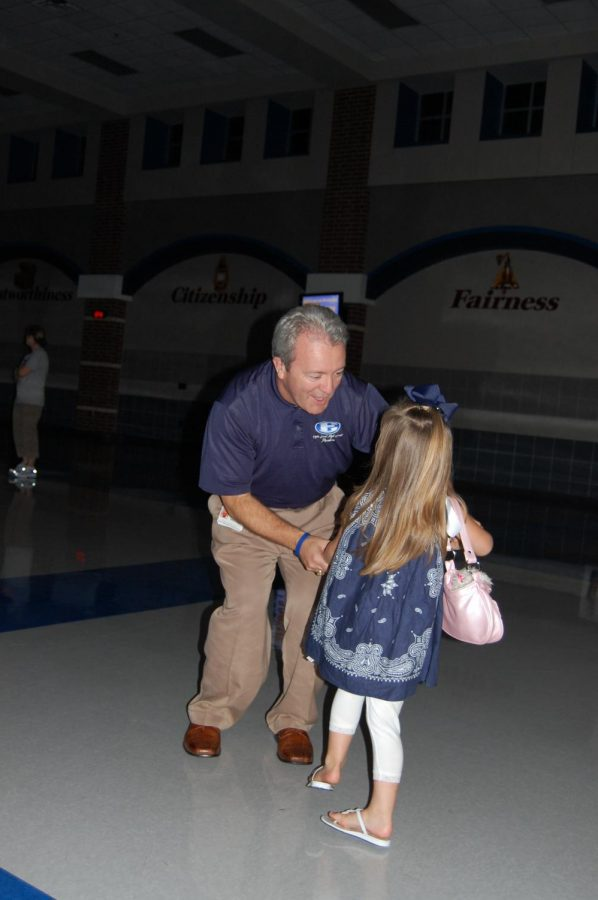 Just dance \\ Mr. Williams hits the dance floor with Tori Thedford at the firstcoming dance in 2010. Before, the school had graduates to come home for homecoming, the fall celebration was called Firstcoming.