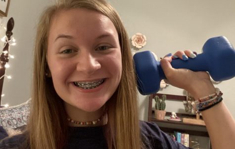 Healthy home \ Sophomore Ryah Hill uses a dumbell to show different ways students can exercise and stay healthy from their home during the Covid-19 pandemic.