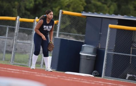 "Practice cancelled // With her mitt in hand, senior Nia Carter practices with her team to prepare for their next game. The girls varsity softball team held a winning record of 13-5 and continued to dominate as a powerhouse. However due to the COVID-19 pandemic, their season came to an abrupt end, affecting both students and staff. ""Our team was something different this year,"" Carter said. ""We had a very strong offense that made it possible for us to win games. We weren't able to start district play, but we knew we started to make some of our opponents chatter about us."""