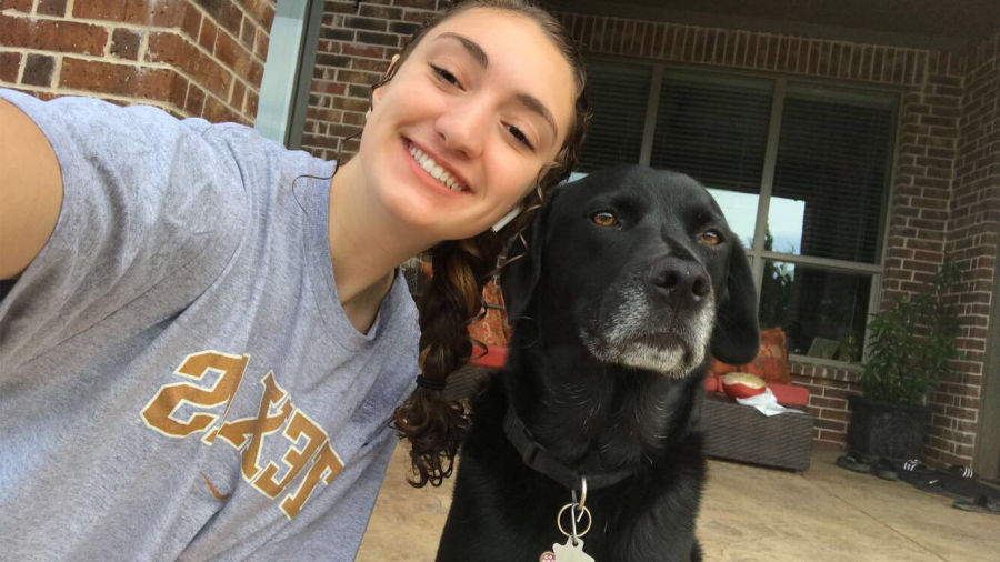 Doggie days \\ Elle, my 5-year-old black labrador mix, stops her playing in the backyard to take a picture with me, while in quarantine April 24. She is the life of this family. Being stuck at home has definitely made me realize her importance.