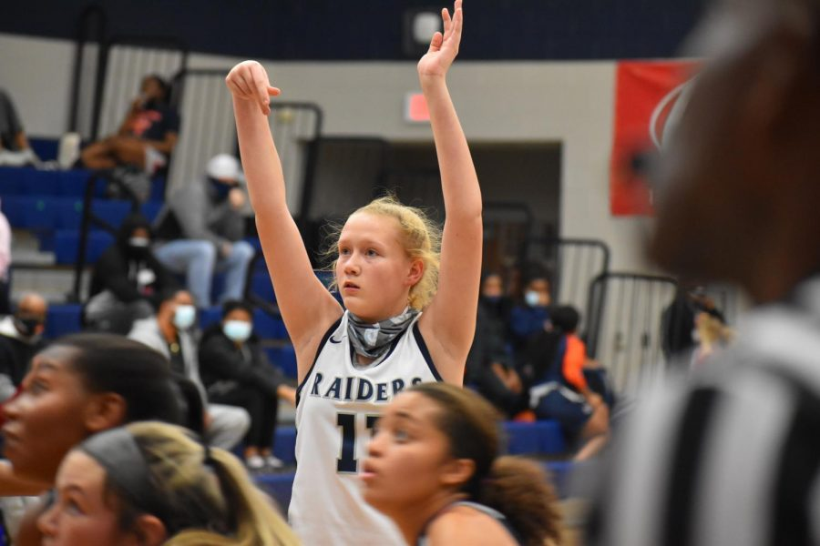"""14-0 \\ Swishing a free throw, freshman Kerbie Cash helps assist her team to a win against McKinney North. The girls varsity basketball team beat the Bulldogs 68-60 and went undefeated in the regular season. """"I play hard every game because I'm not only playing for me, but for my team,"""" Cash said."""