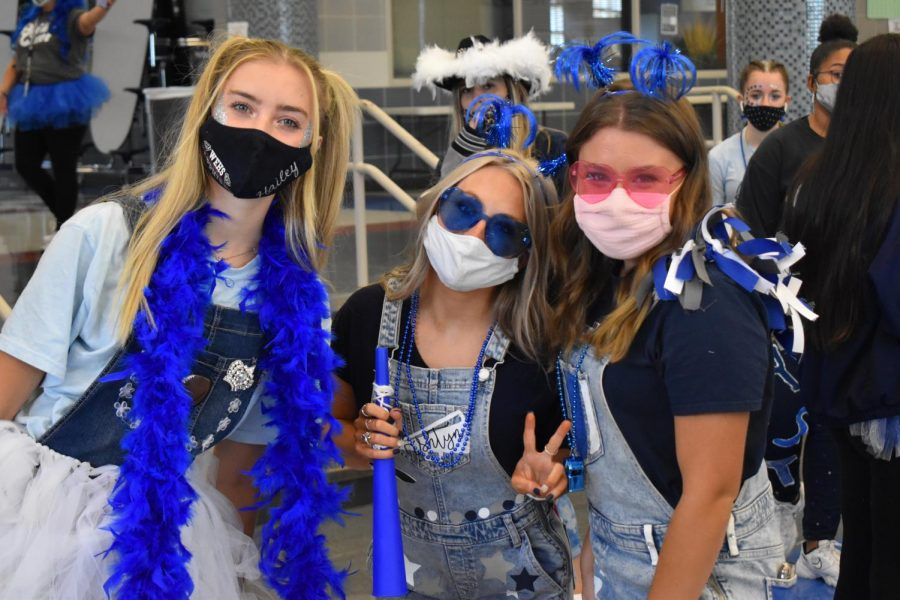 True blue \\ Decked out in boas and bling, juniors Hailey Gummelt, Ashtyn Arp and Campbell Andrews participated in the annual Ultimate Raider contest.
