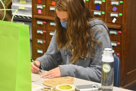 Unmasked \\ Freshman Aubrey Matkoff constructs a mask out of cardboard in Mrs. Bekka Glaze
