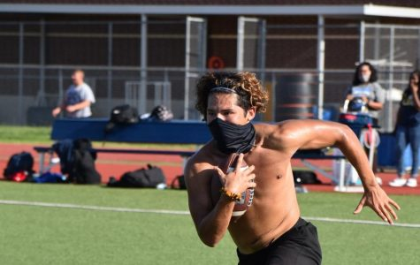 On the run \\ During an after school football workout, senior running back Sergio Aguero, practices without pads, but with his face mask to abide by the new UIL regulations Aug. 17.