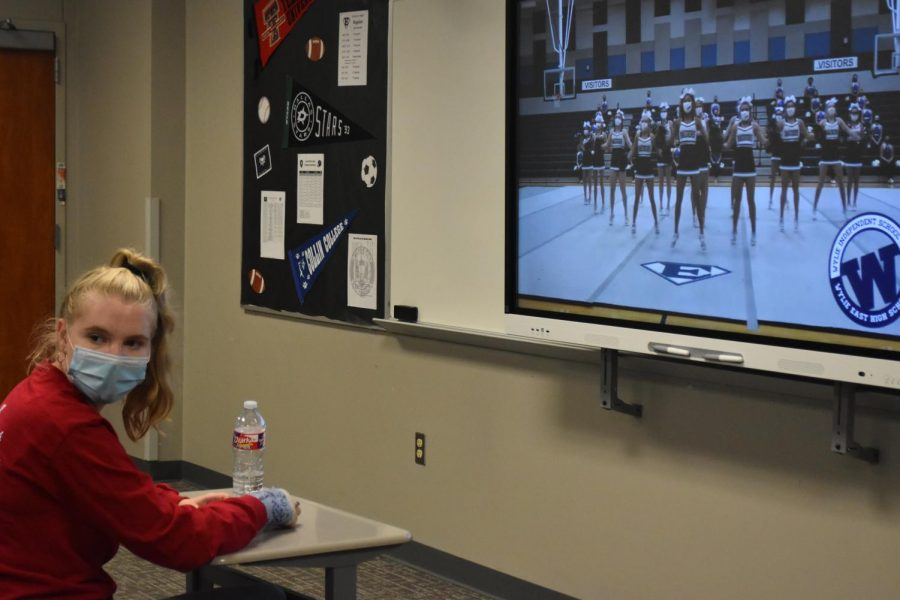 On screen spirit \\ Junior Brittany Erwin watches the pep rally in her second period class. Students took time out of their classes to join together in a safe and socially distanced fashion, to celebrate their school spirit for the first varsity football game.