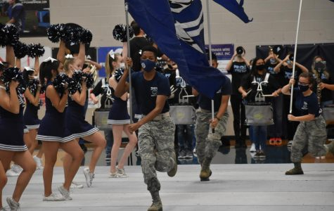 Putting on a performance \\ JROTC runs the Raider flags high and proud as the cheer team chants the Wylie East battle cry during the first ever virtual pep rally.