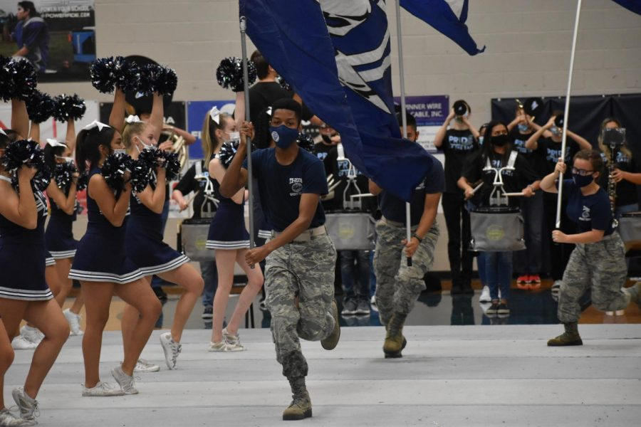 Putting+on+a+performance++JROTC+runs+the+Raider+flags+high+and+proud+as+the+cheer+team+chants+the+Wylie+East+battle+cry+during+the+first+ever+virtual+pep+rally.
