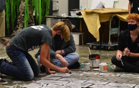 Setting a scene // Painting the set for the upcoming show, Midsummer Night's Dream, sophomore Jude Kurtz adds his finishing touches to the set building. Thespians will perform Shakespeare in the Park Monday, Oct. 12 at Founders Park.