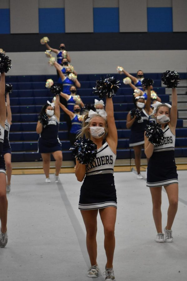 "Cheer up \ Cheer co-captain Ashtyn Arp brings her school spirit to peform at the pep rally with her teammates. ""My favorite part was just the fact that we were all together and doing what we love again,"" Arp said."