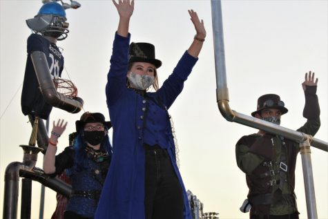 Steam-Punk Rock \\ Junior Rachel Pitcock waves to the crowd at the Homecoming parade on the Robotics and Engineering organization's winning musical steampunk float.