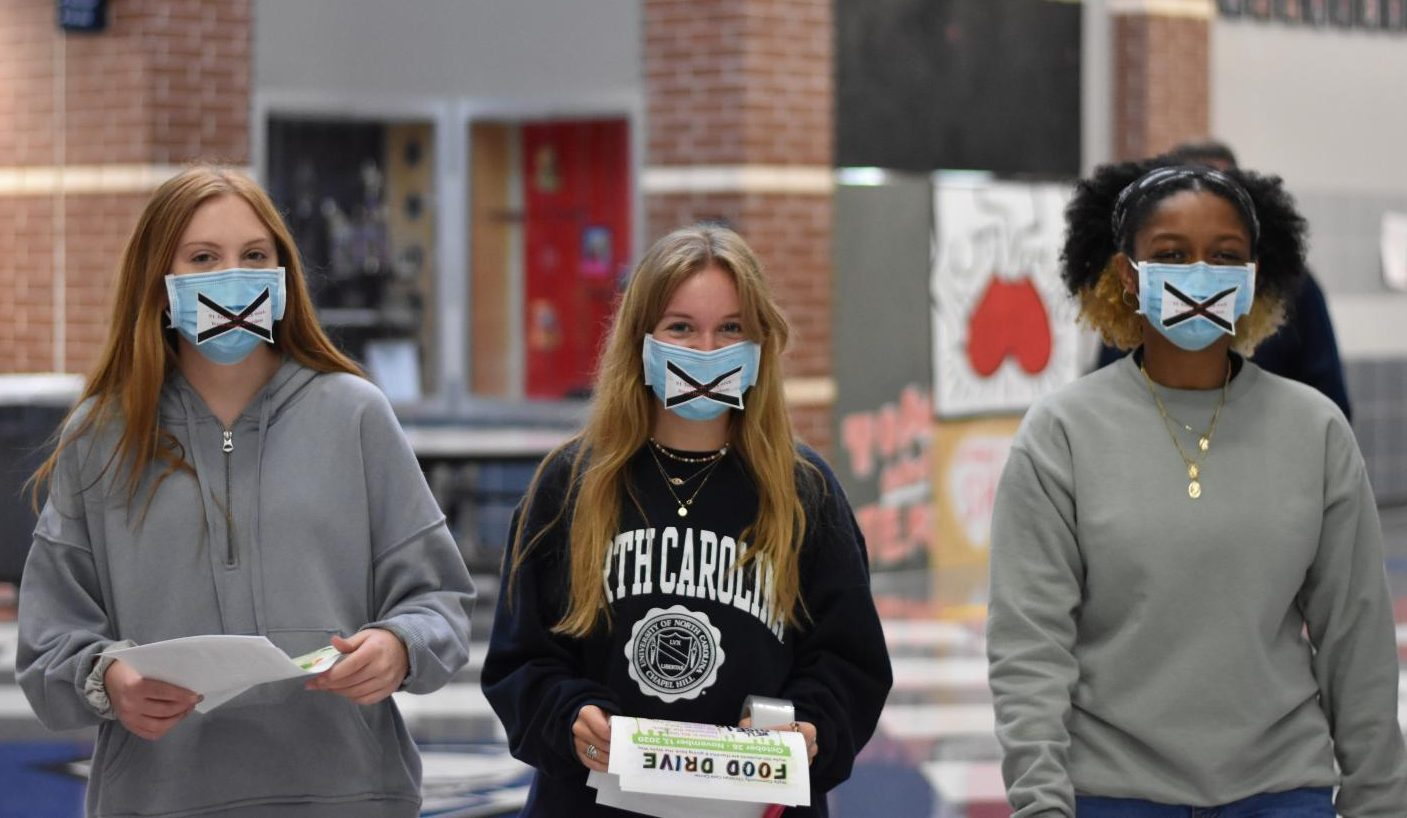 """Walk in silence \\ Participating in the """"Silent Truth"""" day, juniors Ashleigh Bycott, Ryah Hill and Redieat Samson take a day of silence in honor of Red Ribbon Week and the effects of drugs on teenagers. Student Council hosted the event, inviting organizations all around the school to participate by asking several of their members to go silent. """"It was such a difficult thing to do, especially coming from a chatty person, but it made it much more significant to understand the true effects drugs can have on anyone."""""""
