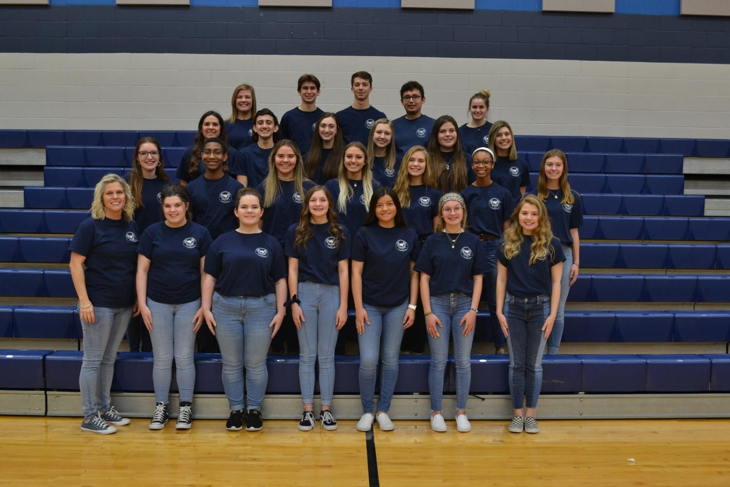 Shining stars // The yearbook staff of the 2019-2020 school year smiles for their club photo. Their Peak-themed yearbook earned the highest rating of Distinguished Merit.