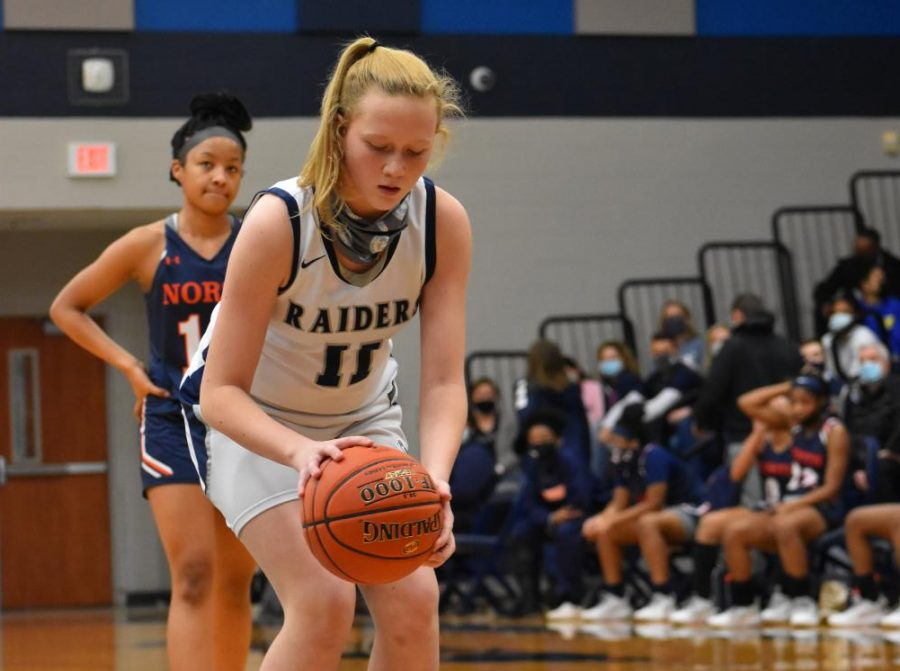 Get your swish on \\ Shooting a free throw, freshman Kerbie Cash plays against McKinney North High School. She is on varsity which makes her the youngest one on the team.