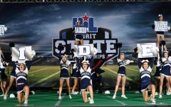 Navigation to Story: Cheerleaders reflect on recent success