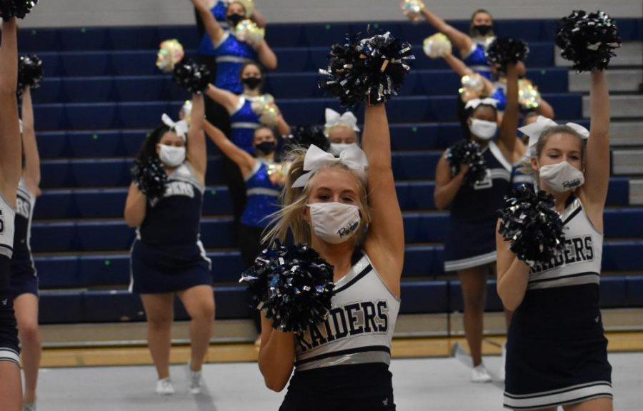 "No contact \ Junior Ashtyn Arp cheers during the filming of the virtual pep rally. To ensure she won't miss a cheer competition, Arp chose to move to remote learning. ""I'm just glad I'm still able to go to practice and take care of the job I uphold on my team,""Arp said."