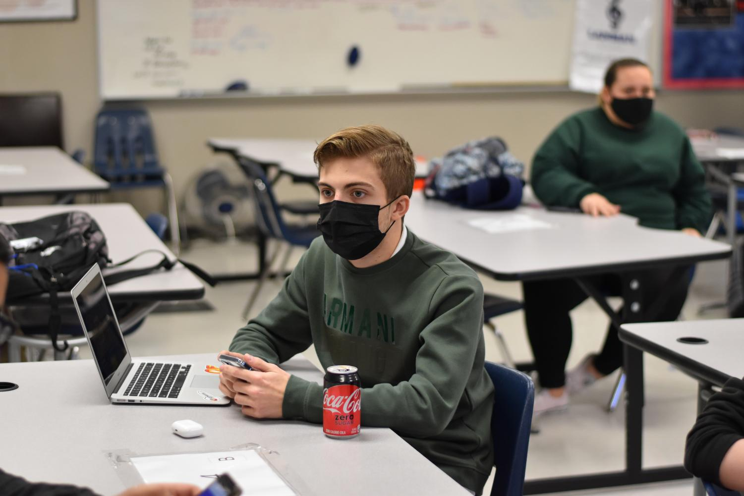 Pay attention \\ Listening to his teammates, sophomore Carson Tittle talks at practice with his Quiz Bowl team. SkillsUSA state competitions will be held virtually this year.