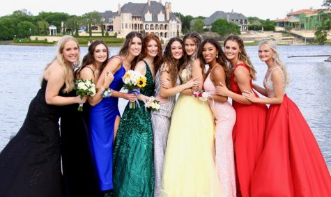 Girls night \\ Posing during their prom photos, a group of senior girls stand together in Adriatica Village May 8. Prom expenses are costly.