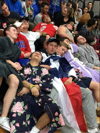 """Sleep fest \ Students wear pajama gear to the basketball game against Denison so that they could """"sleep on them"""" to annoy the other team."""