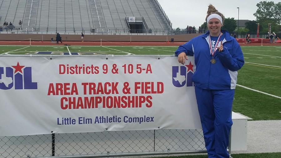 Winning big \\ Junior Halie Daniel's smile indicates her first place overall at the 9&10-5A Area track meet April 23. She qualified for the Regional track meet taking place May 1-2.
