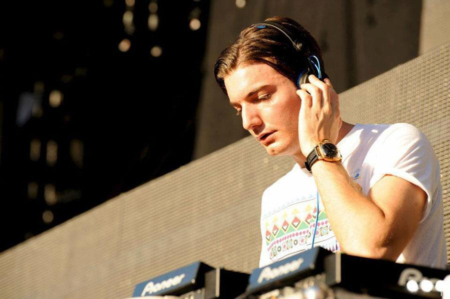 Too cool \\ Performing live, Alesso is the DJ  at an outdoor music festival.