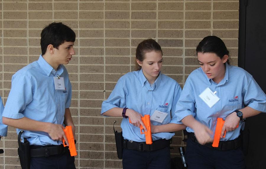 CSI Waco \\ SKILLS USA members Joshua Guevara, McKenna Steiner and Haley Proctor prepare to enter the building search contest area. The team placed third.
