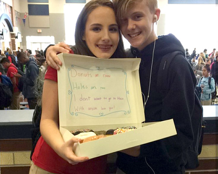 Will you? // Students find unique ways to ask dates to homecoming.  Freshman Hayden Huckabee used freshman Ashton Huffs favorite food in his hoco proposal.