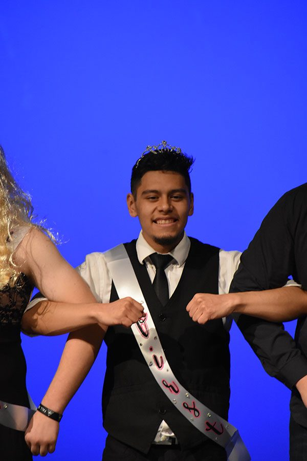 Taking home the win //  Senior Sebastian Garcia is crowned the Big Man on Campus during the fourth annual pageant Nov 9.