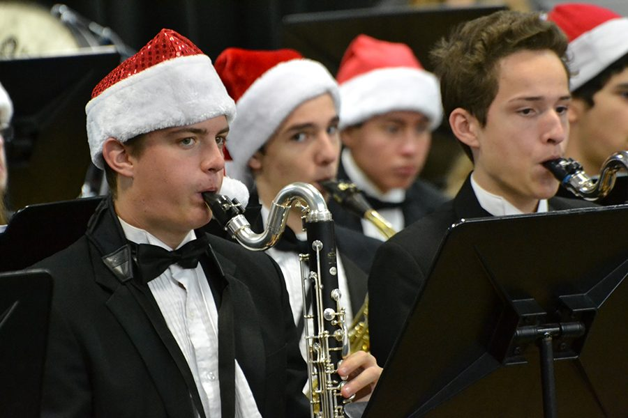 Clarinet Christmas // Playing their bass clarinets, junior Wylie Dunham and freshman Ryan Rodarte spread holiday cheer by performing multiple traditional Christmas pieces at Birmingham Elementary for students during the Wind Symphony elementary tour Dec. 12.
