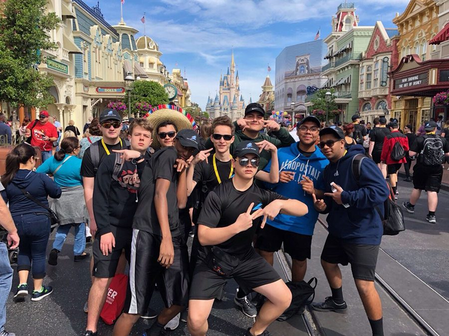 Making magic // Posing in front of Cinderella's Castle, students enjoy their last day at Disney World's Magic Kingdom March 10. Fine Arts students traveled to Orlando to march in a Disney parade.